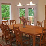 Dining room looks over meadow along the McKenzie River.